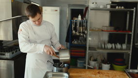 Professional chef man prepare gravy sauce with spices at restaurant kitchen stock footage