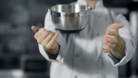 Professional chef playing with kitchen tools. Close up chef hands rolling bowl. Professional chef playing with kitchen tools. Close up chef hands rolling steel stock footage