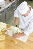 Professional chef preparing mushrooms in large kitchen Royalty Free Stock Photography