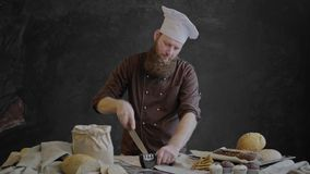 Chef sharpen the knife and check the sharpness stock video footage