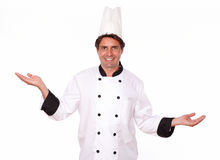 Professional chef standing with palms out Stock Photos