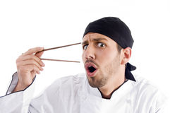 Professional chef surprised with chopstick Royalty Free Stock Images