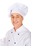 Professional chef in white uniform and hat Stock Photography