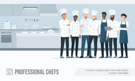 Professional chefs in the kitchen. Professional chefs standing together in the restaurant`s kitchen Royalty Free Stock Photos