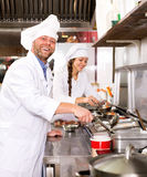 Professional chefs working at take-away Stock Images