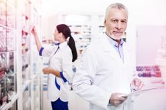 Professional chemists actively working in a modern pharmacy stock photo