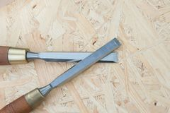 Chisels on a natural wooden background. Professional Chisels on a natural wooden background, Place for text Royalty Free Stock Photo