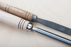Chisels on a natural wooden background. Professional Chisels on a natural wooden background, Place for text Stock Image