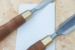 Chisels on a natural wooden background. Professional Chisels on a natural wooden background, Place for text Royalty Free Stock Photos