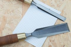 Chisels on a natural wooden background. Professional Chisels on a natural wooden background, Place for text Royalty Free Stock Images