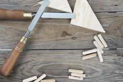 Three Chisels on a pink background. Professional chisels on a pink wood background. Visible wood grain Royalty Free Stock Photos