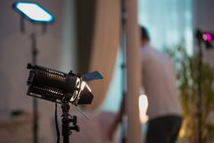 Professional cinema lamps. With continuous light standing in the dark room royalty free stock images