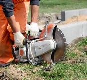 Professional circular saw for work on concrete. In hands at the worker royalty free stock photography