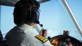 Professional civil aviation pilot passing flight details to controller via radio. Stock footage stock video