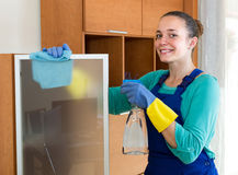 Professional cleaner  cleaning the office Royalty Free Stock Images