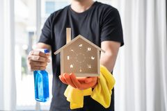 Professional cleaner shows shows the Cleaning Logo stock photography