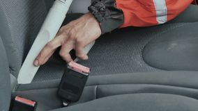 Professional cleaner vacuum the seat of car. Close-up. Car washman cleans the interior of automobile. Worker uses vacuum cleaner to clean the cabin of car from stock video footage