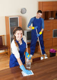 Professional cleaners. Team of professional cleaners cleaning in living room stock image