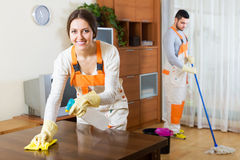 Professional cleaners with equipment clean Stock Images