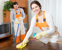 Professional cleaners with equipment clean. Happy professional cleaners with equipment clean furniture of client house royalty free stock photo