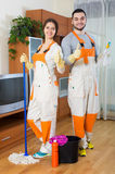 Professional cleaners with equipment clean Royalty Free Stock Images