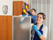 Professional cleaners team working. At living room Stock Images