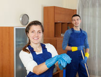 Professional cleaners in uniform. Cleaning in room Stock Photos
