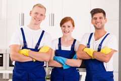 Professional cleaners in uniforms. Happy and young professional cleaners in uniforms royalty free stock images