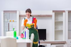 The professional cleaning contractor working at home. Professional cleaning contractor working at home Royalty Free Stock Photo