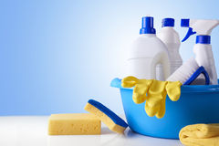 Professional cleaning equipment on white table overview. Professional cleaning equipment on white table and blue background overview. Cleaning tools company stock image