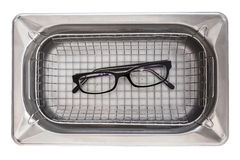 Professional cleaning glasses with an ultrasonic cleaner Stock Images