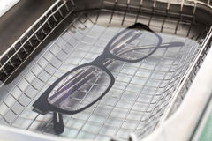 Professional cleaning glasses with an ultrasonic cleaner Royalty Free Stock Image