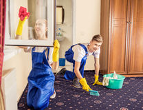Professional cleaning servise carpet and windows in room Royalty Free Stock Photo