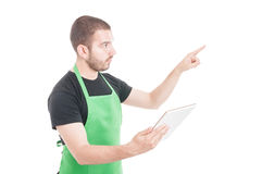 Professional clerk indicate or showing something. And holding tablet on white background Stock Photos