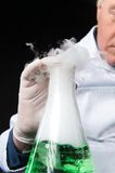 Professional clinician studies in laboratory using flask. Stock Image