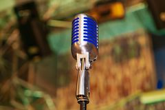 Professional closed up microphone is intended for performances in front of audience on the concerts royalty free stock images