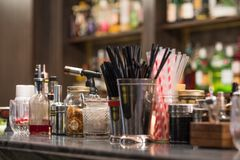 Professional cocktail tools and ingredients in glass bottles and jars for creative modern fashionable cocktails on bar counter. Cocktail tools and ingredients stock photography