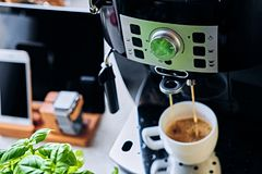 Coffee machine  and communication set of smart watch, tablet PC Royalty Free Stock Image