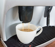 Professional coffee machine making espresso. In a cafe Stock Image
