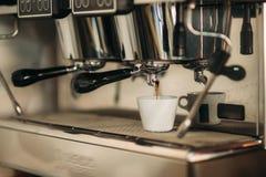Professional coffee machine making espresso in cafe stock image