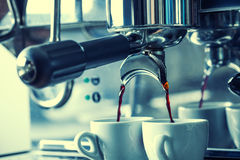 Professional coffee machine making espresso in a Two cafe. Royalty Free Stock Photography