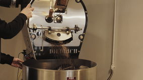 Professional coffee roasting process in artisan lab stock video footage