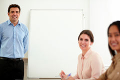 Professional colleagues group smiling at you Royalty Free Stock Images