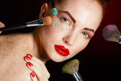 Professional colorful makeup for red-haired models Stock Photo