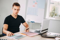 Professional colorist working with color palettes stock image