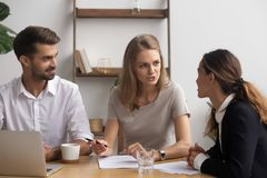 Professional company staff negotiating sitting together in office. Satisfied professional company staff negotiating sitting together in office feeling good stock photos