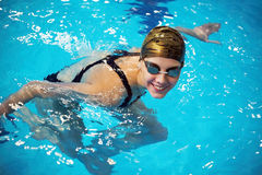 Professional competitive swimmer. Portrait of Female professional competitive swimmer in swimming pool Stock Photo