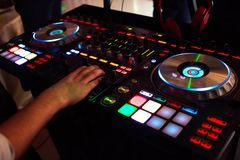Professional concert dj turntables player device with sound mixer panel and jog wheel.Club disc jockey stage equipment for playing stock photos