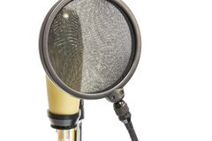 Professional condenser microphone with pop filter. Isolate professional condenser microphone with pop filter in white background Stock Photography