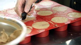 A professional confectioner making mono portion cookies for an event.  stock video